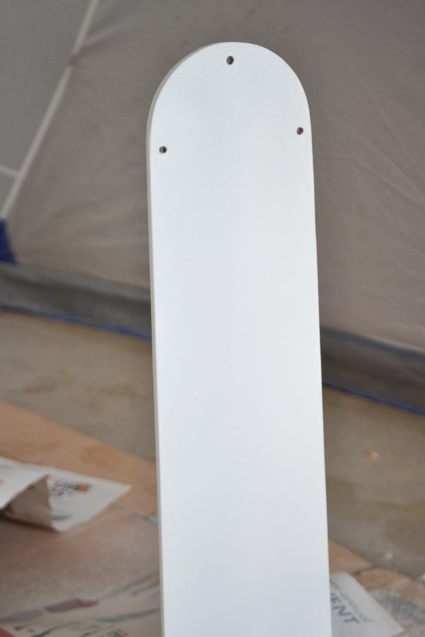 A close up of a fan blade painted white