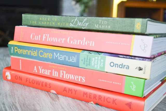 A stack of five colorful floral books pictured close up