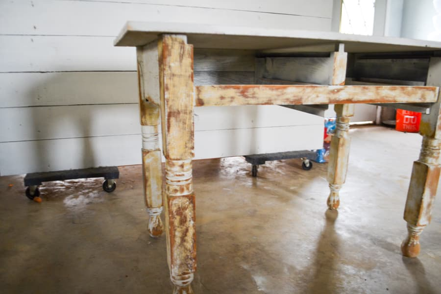 Sanded table legs in front of a white shiplap wall