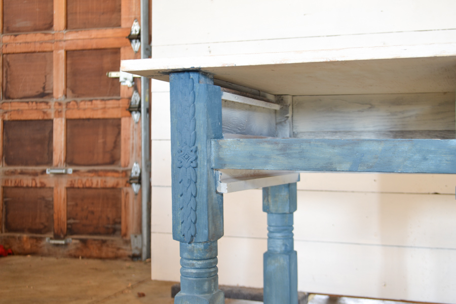 Table legs painted with one coat of blue milk paint with a white top