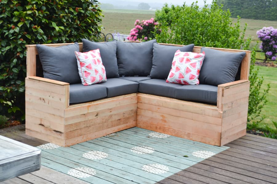 A close up of the front of an all wood sectional