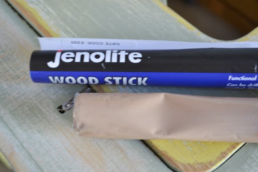 A close up of a jenolite wood stick on a table
