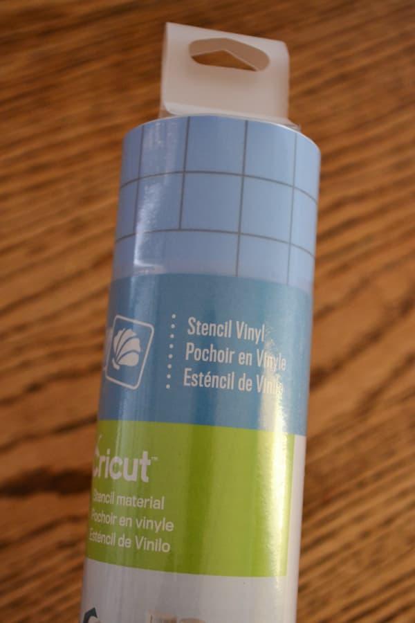 A close up of a roll of blue Cricut machine stencil material