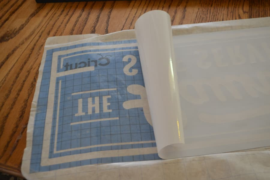 A close up of transfer paper being pulled off a stencil design