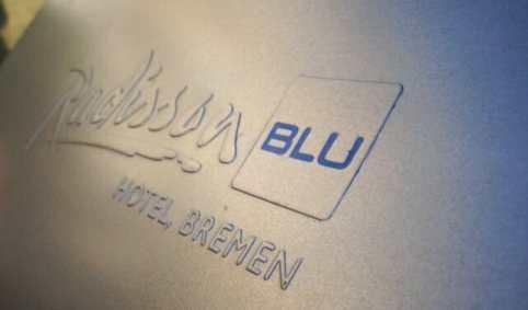 Eine Prägung eines Logos auf einer Metalldose