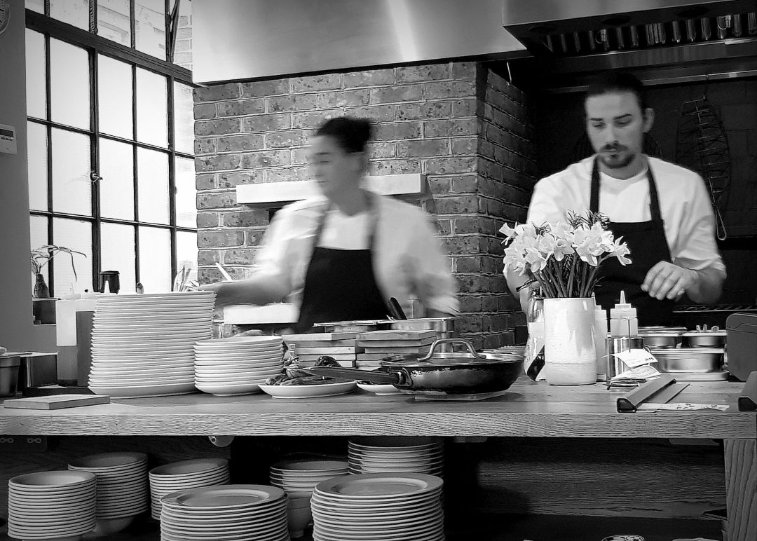 Review of Brat restaurant London, from the dining space, you can see chefs prepare the dishes.
