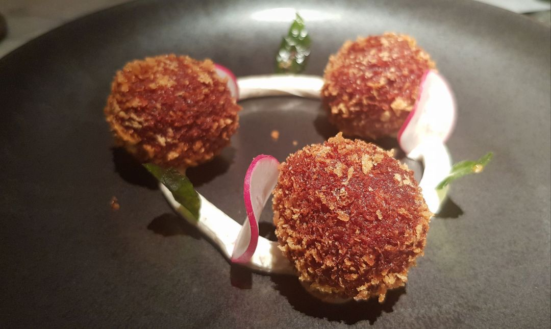 Indian Accent services up a dish of beetroot vadai, crispy fritters of sweet beetroot, served up with goats cheese.