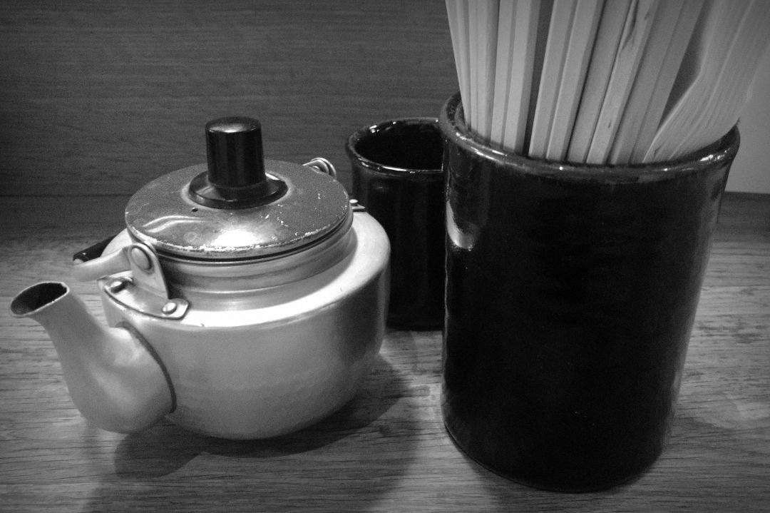 Still life photo of teapot and chopsticks in black and white