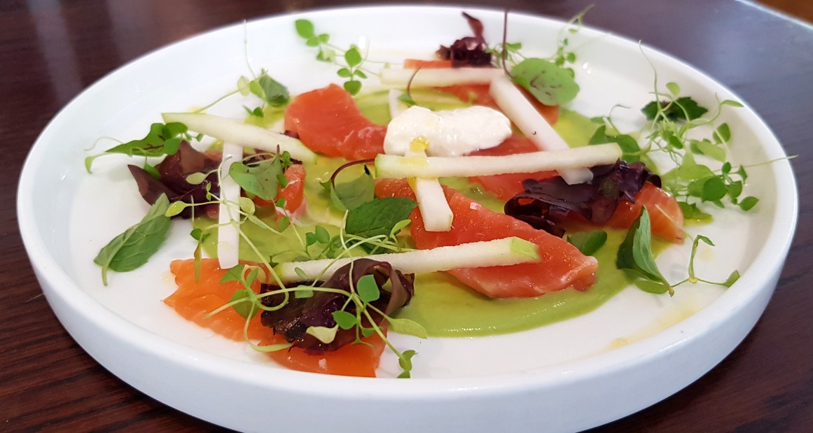 Summer dish of crudo sea trout and microleaves at London restaurant Clipstone