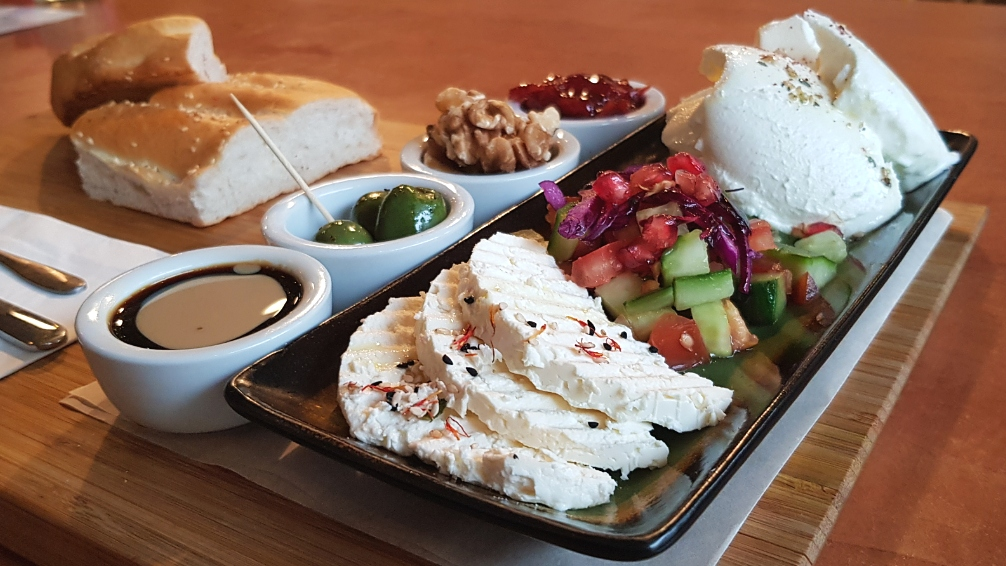 The Kurdish breakfast at Nandine comprises cheese, yoghurt, olives, walnuts, and bread