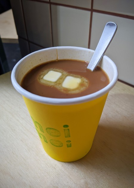 A cup of kopi gu you - butter coffee - a classic hot beverage of Singapore.