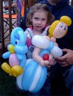 girl holding baloons