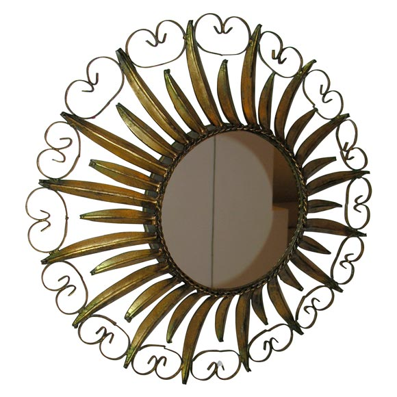 Spain, 1950s gilt sunburst mirror with scrollwork frame