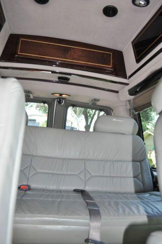 power reclining leather sofa sets red microfiber buy used 2007 gmc savana high top custom van by regency ...