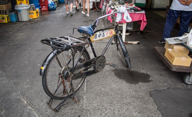 """One of the many delivery bikes among the market stalls. These were not just for show, as I first assumed, just """"well loved."""""""