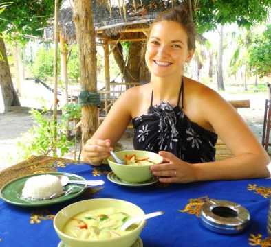 Meg & her favorite food:  Enjoying Green Curry in Thailand