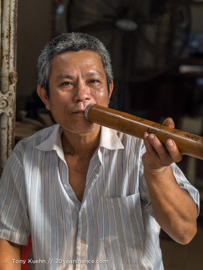 Vietnamese man with pipe