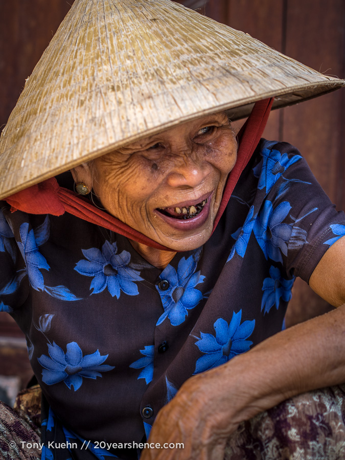 Photogenic old lady in conical hat in Hoi An, Vietnam