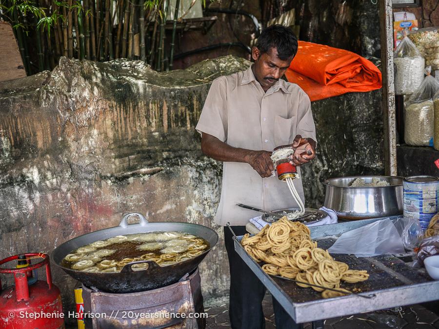 A man makes jalebis
