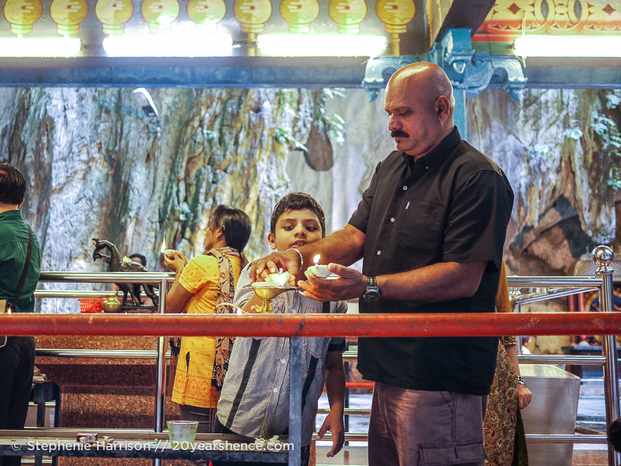 Man with son at Batu Caves