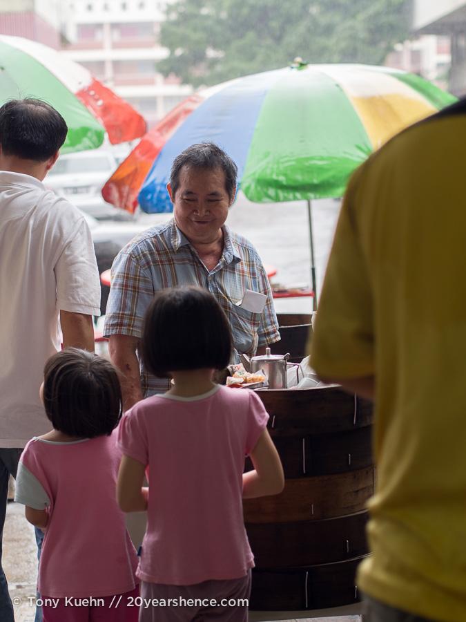 A man serves dim sum in Kuala Lumpur