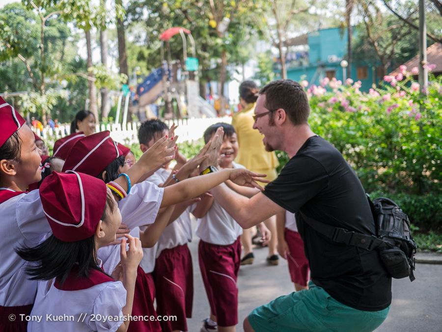 Tony plays with Vietnamese students, Ho Chi Minh City