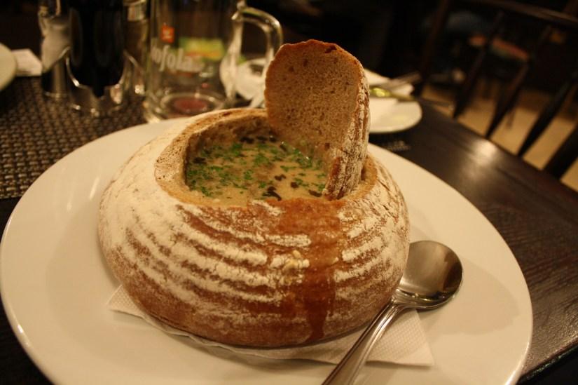 Soup in a bread bowl in Prague, Czech Republic