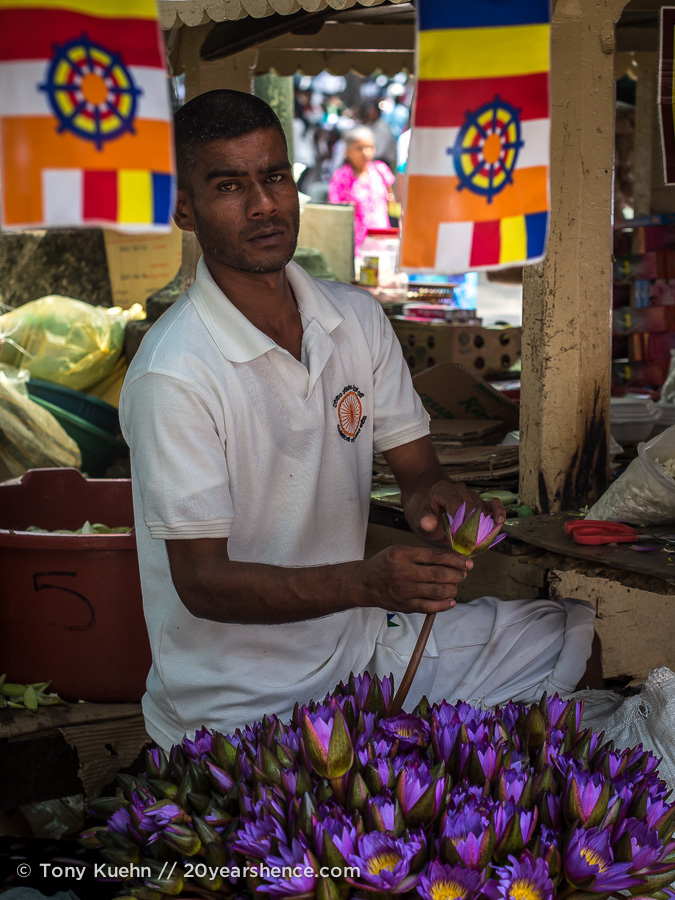 A flower market vendor outside the Temple of the Tooth, Kandy, Sri Lanka