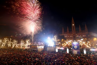 Fireworks explode over Vienna's city hall during New Year's Eve celebrations at the 'Wiener Silvesterpfad' event in Vienna
