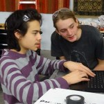 Evan and Isaiah working on programming.