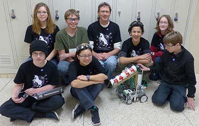 FTC Team 9459: Adrian, Elizabeth, 9459 robot, Cian, Liza, Ethan, Michael, Emilio, Zack.