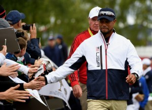 CHASKA, MN - SEPTEMBER 28: Vice-captain Tiger Woods of the United States high fives fans during practice prior to the 2016 Ryder Cup at Hazeltine National Golf Club on September 28, 2016 in Chaska, Minnesota. (Photo by Ross Kinnaird/Getty Images)