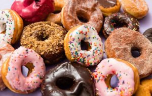 Loyal doughnut eaters buy out shop daily so owner can visit sick wife