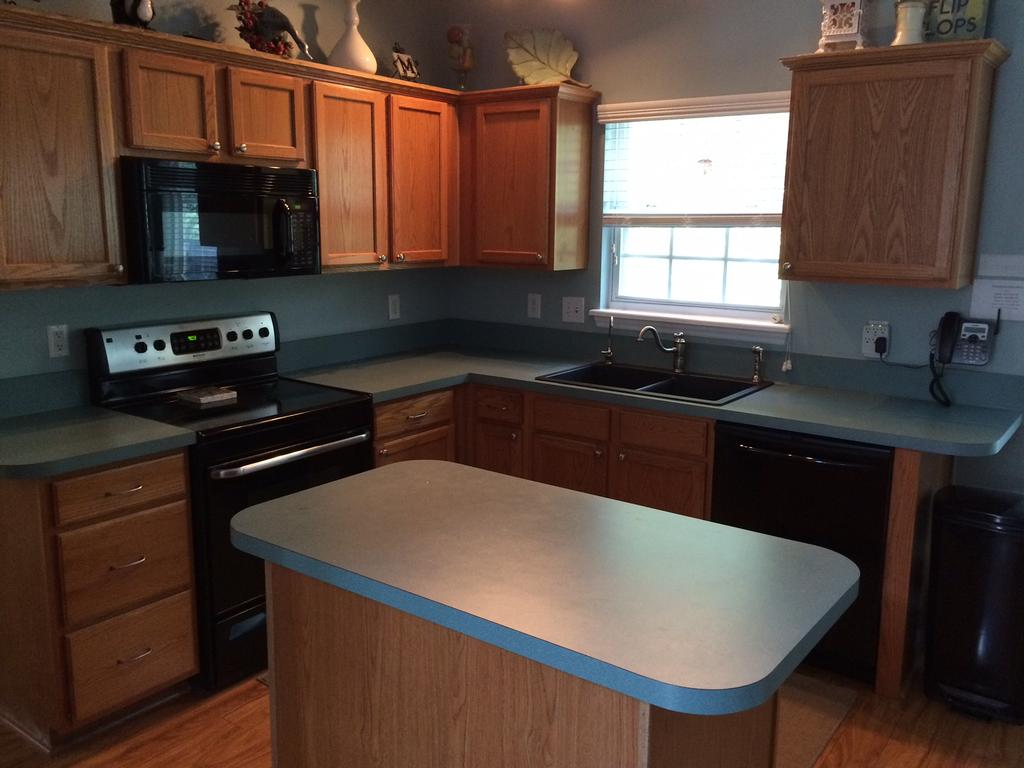affordable kitchen cabinets hgtv backsplash pure white with dovetail gray island - 2 cabinet ...