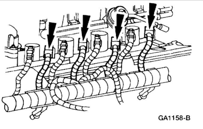 OIL IN SPARK PLUG WELLS: Engine Performance Problem V8