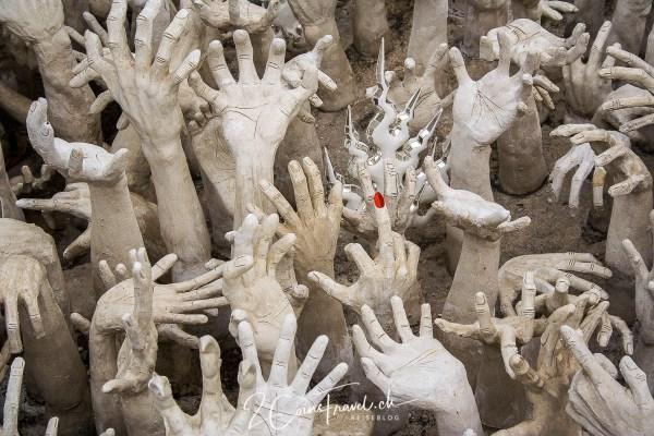 Finger der Höhle Wat Rong Khun