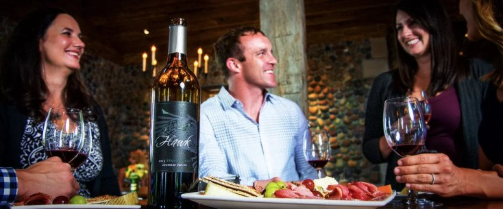 Friends Enjoying a Wine Tasting at 2Hawk Vineyard and Winery