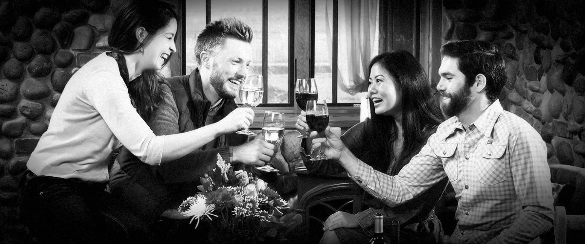 Couples Toasting in 2Hawk Vineyard and Winery Tasting Room (Grayscale)