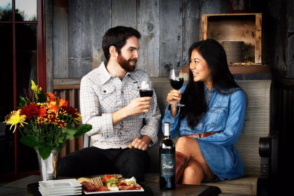 Couple Enjoying Wine Accompaniments Outside 2Hawk Vineyard and Winery Tasting Room