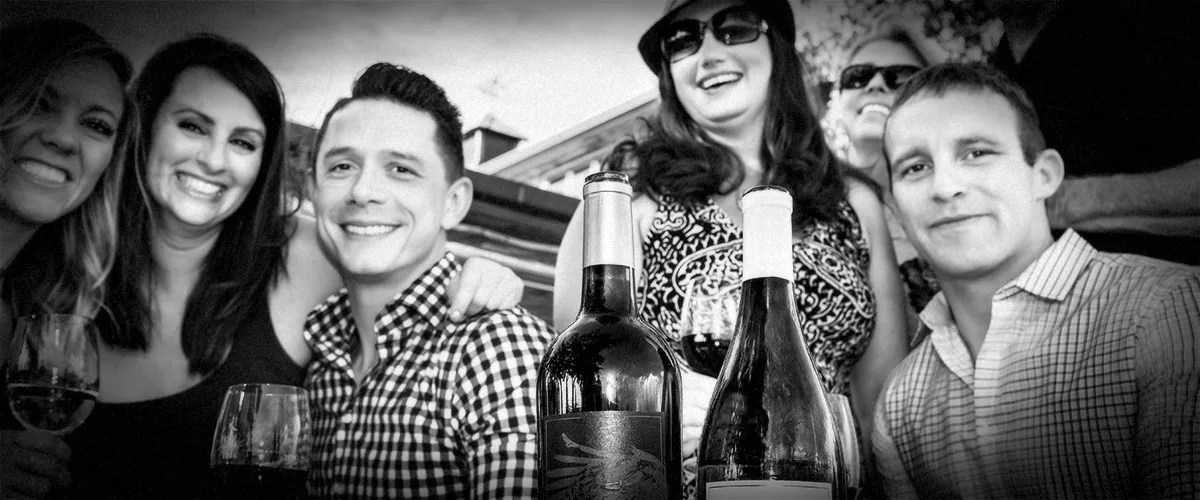 Friends Wine-Tasting Outdoors at 2Hawk Vineyard and Winery (Grayscale)