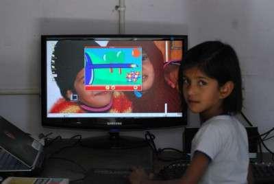My niece playing Gcompris in Edubuntu