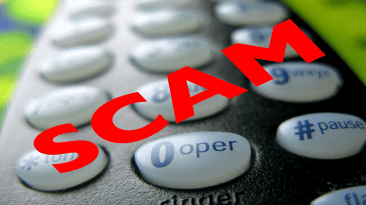 """Picture of a telephone handset with the word """"scam"""" imposed over it."""