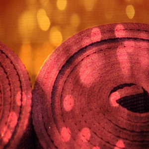 A close-up of two rolled yoga mats