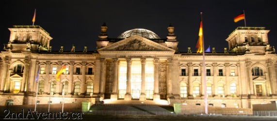 The exterior of the Reichstag building in Berlin at night