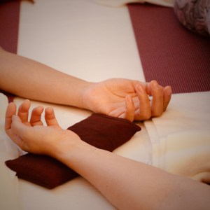Soft relaxed savasana hands