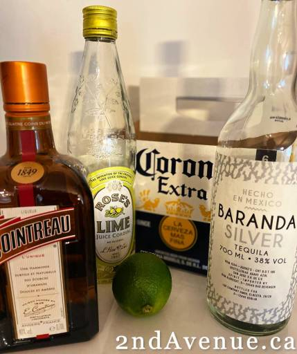 Cointreau, Rose's Lime, Corona Extra beer, silver tequila and a lime - the ingredients for my perfect margarita