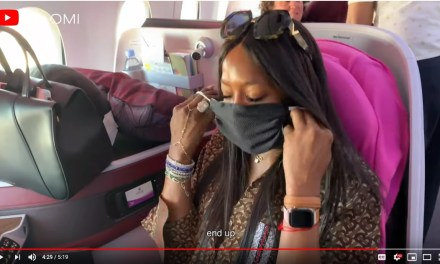 Naomi Campbell pointlessly cleans her Qatar business class seat