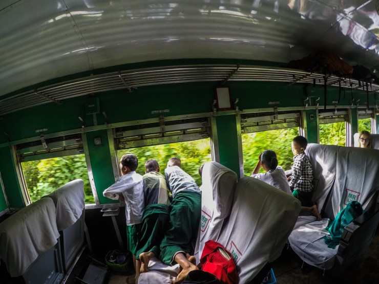 Excited schoolkids riding the train to their village