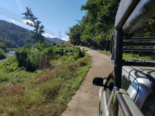 The road out of Pai to the river passes by garlic farms and majestic mountains