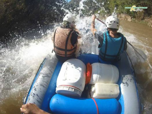 Crashing into big waves in a nasty stretch of rapids